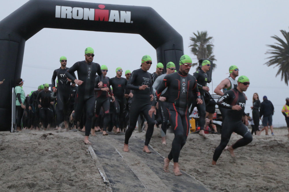 In my Hurricane TYR Wetsuit charging in to the water. At the start of the SuperSeal Olympic Distance with my Age Group.