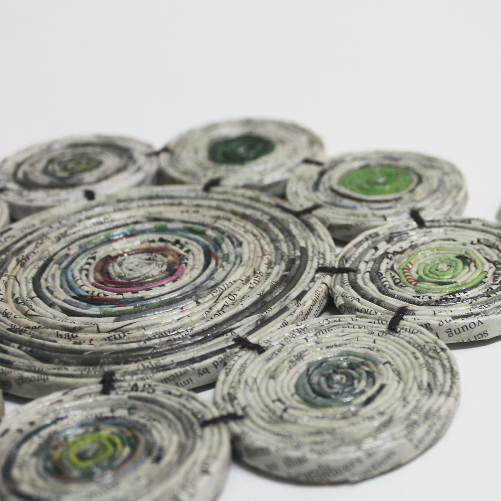 Recycled newspaper coaster