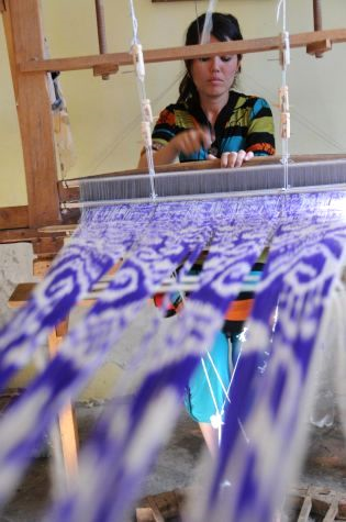 Hand weaving on a traditional loom