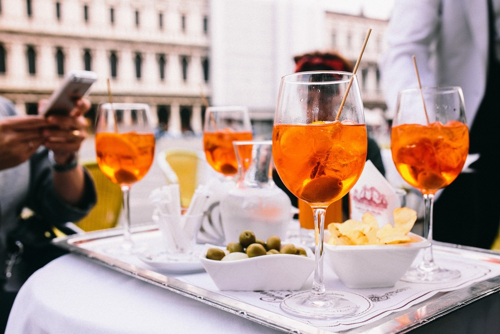 kaboompics.com_Glass of aperol spritz cocktail with olive and orange piece (1).jpg