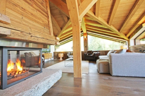 Perfect cosy interior with roaring fire at Chalet Les Praz.