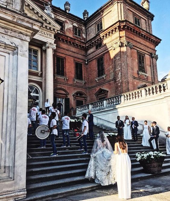 The magnificent Castello Di Racconigi in Italy was the backdrop for Alexandra's nuptials. Bridemaids wear TH&TH Privé. Photo by  @annarvitiello