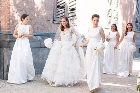 More from Alexandra's stunning Italian wedding. Bridesmaids wearing TH&TH Privé. Photo by  Margherita Borsano