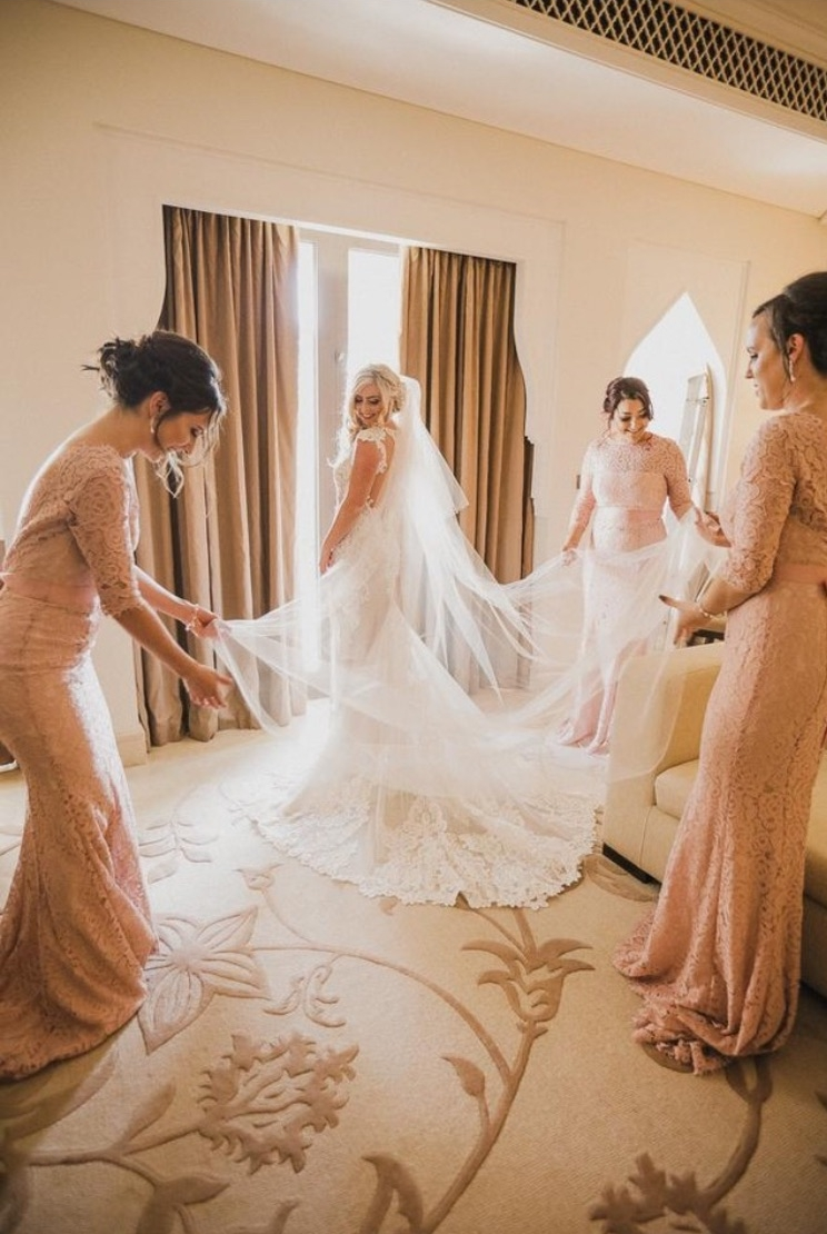 Sophie's bridesmaids wearing Alara in Blush.