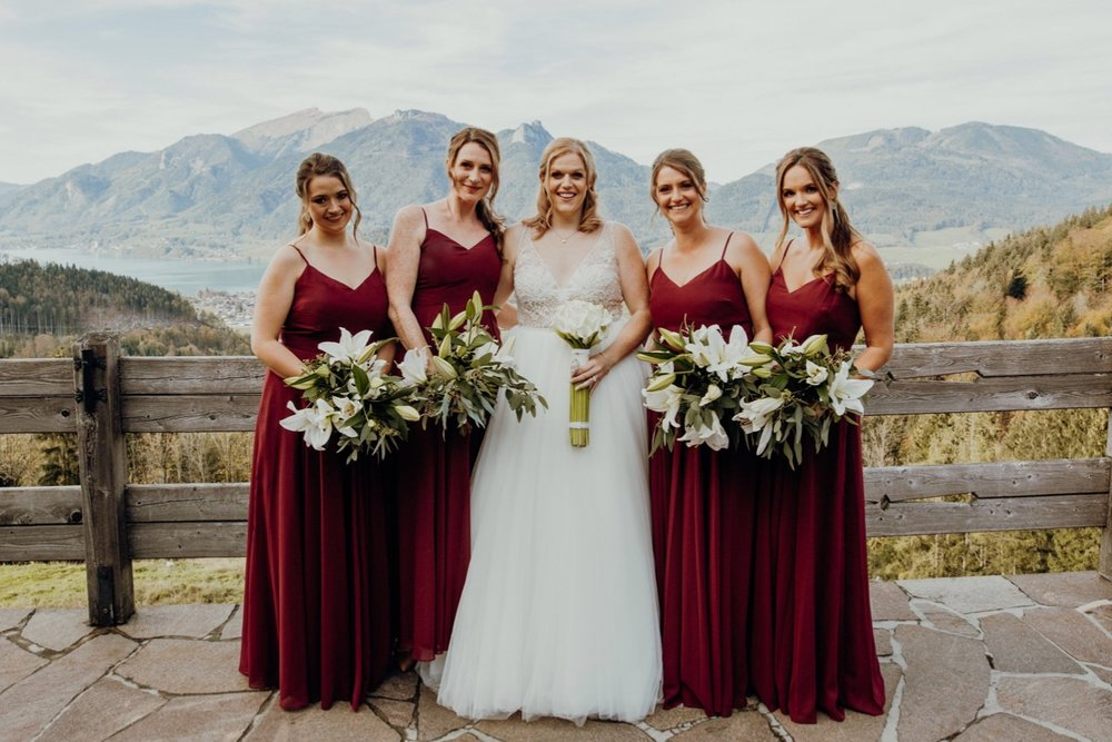 Amy's beautiful Austrian wedding. Her best girls wear our Edie gown in Roseberry - Photo  The Click
