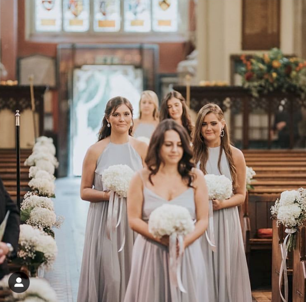 Processional perfection for April's bridesmaids wearing a mix of Edie & Olympia in Silver Mist. Photo  Matt Fox Photography