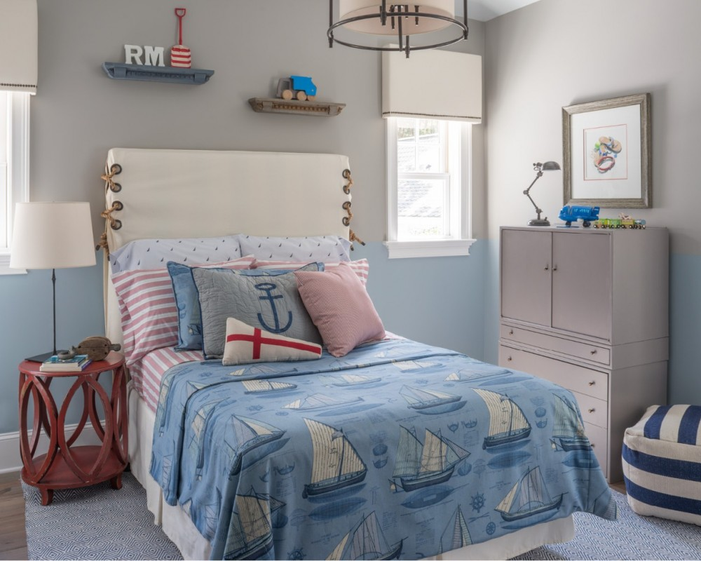 A boy's bedroom in a nautical theme is just right for a beach house.