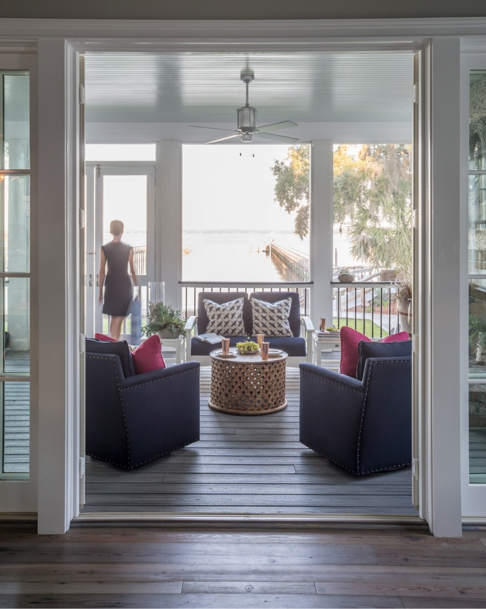 A large, comfortable screened porch welcomes breezes and views of Port Royal Sound and Hilton Head Island.