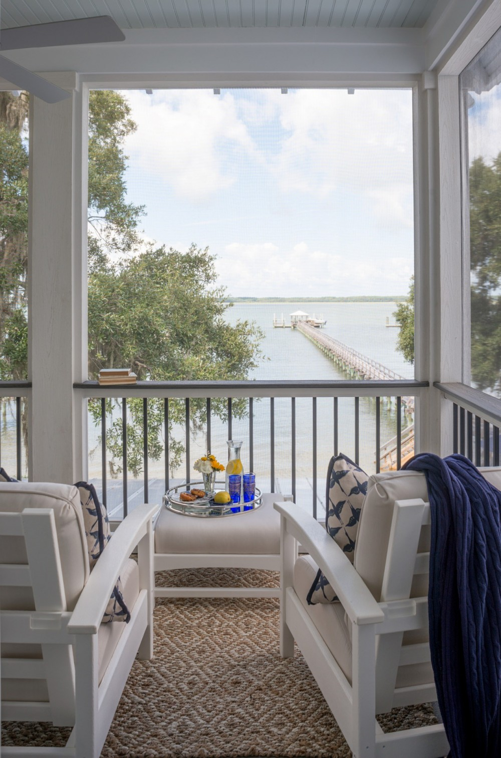 The back screen porch is a prime spot for an   apres  -sun snack and sip overlooking Port Royal Sound.
