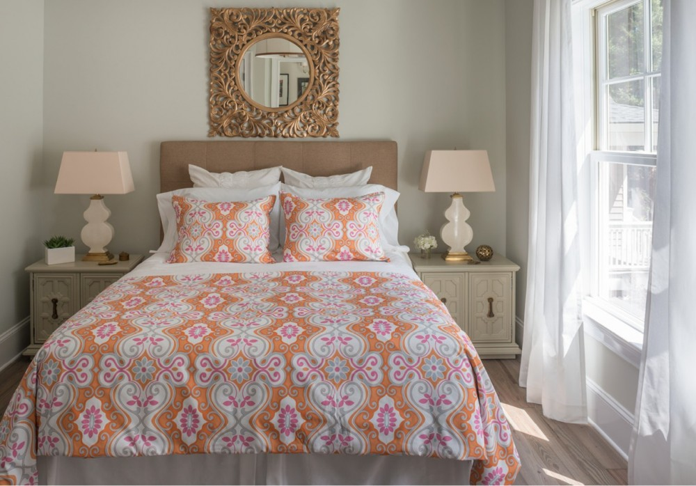 The second-floor guest room's exuberant hues are tempered by elegant bronze accents.