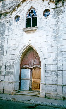 The present condition of the entrance to the formerly beautiful chapel of the Trinitarian Priests School.  Photo taken by Victor L. Maruri, 1996.