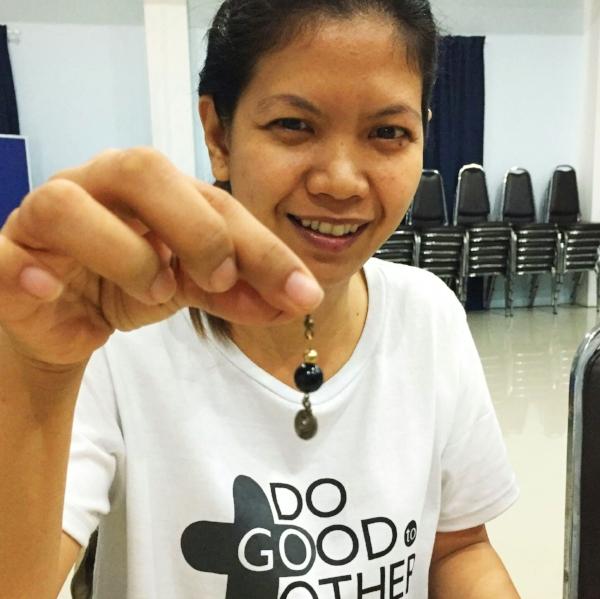 Earring class in Thailand where nine women