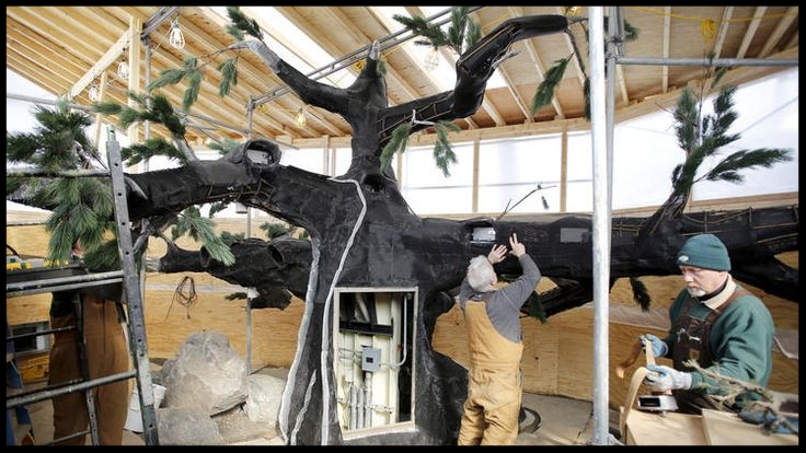 Staff work to build a naturalistic feeder device for the Red Pandas at Brookfield Zoo. Once on exhibit, it'll blend right in with the rest of the vegetation and be barely noticeable.  (Photo Credit: Chuck Berman / Chicago Tribune)