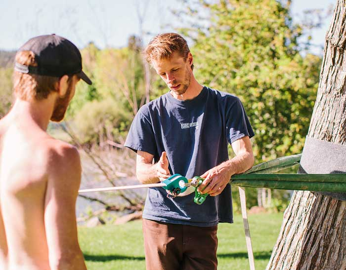 Jason Fautz talking slackline tech with a local in Bend, OR.