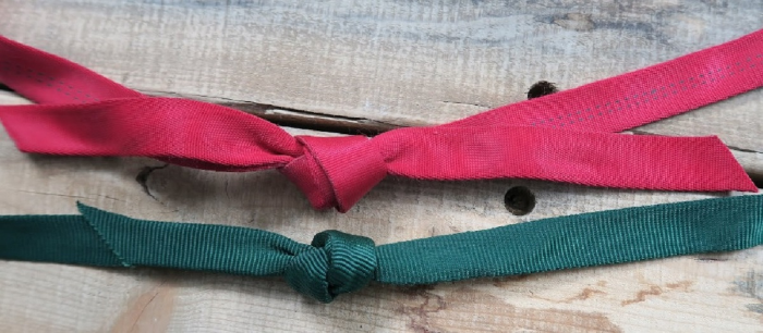A water knotted (top) and beer knotted (bottom) sling made from tubular webbing. Popular choice for primitive setups.