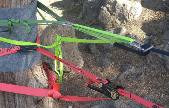 Notice how the tail ends of each slackline is tied off to the tree using a bowline knot. This helps prevent flying gear in the event of a failure.