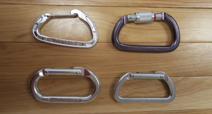 A selection of aluminum carabiners. The ovals are nice for primitive slacklines. Any of them is suitable for the multiplier in a pulley system. None are suitable for any other high load bearing situation.