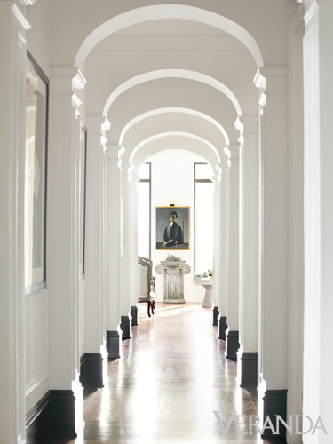 veranda arched hallway black and white baseboards two toned cococozy arch hall new york city apartment nyc columns colonnade