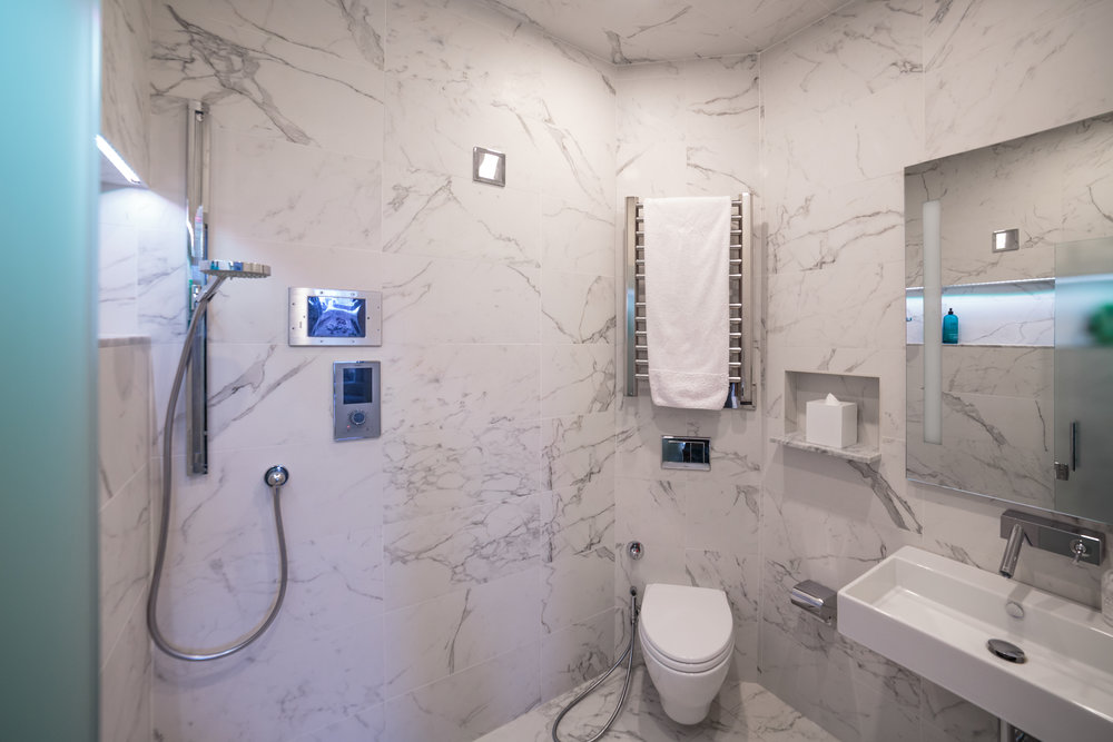 Designed by Marie Burgos Design - Photo credit Francis Augustine   Marvel  Calacatta by Nemo Tiles