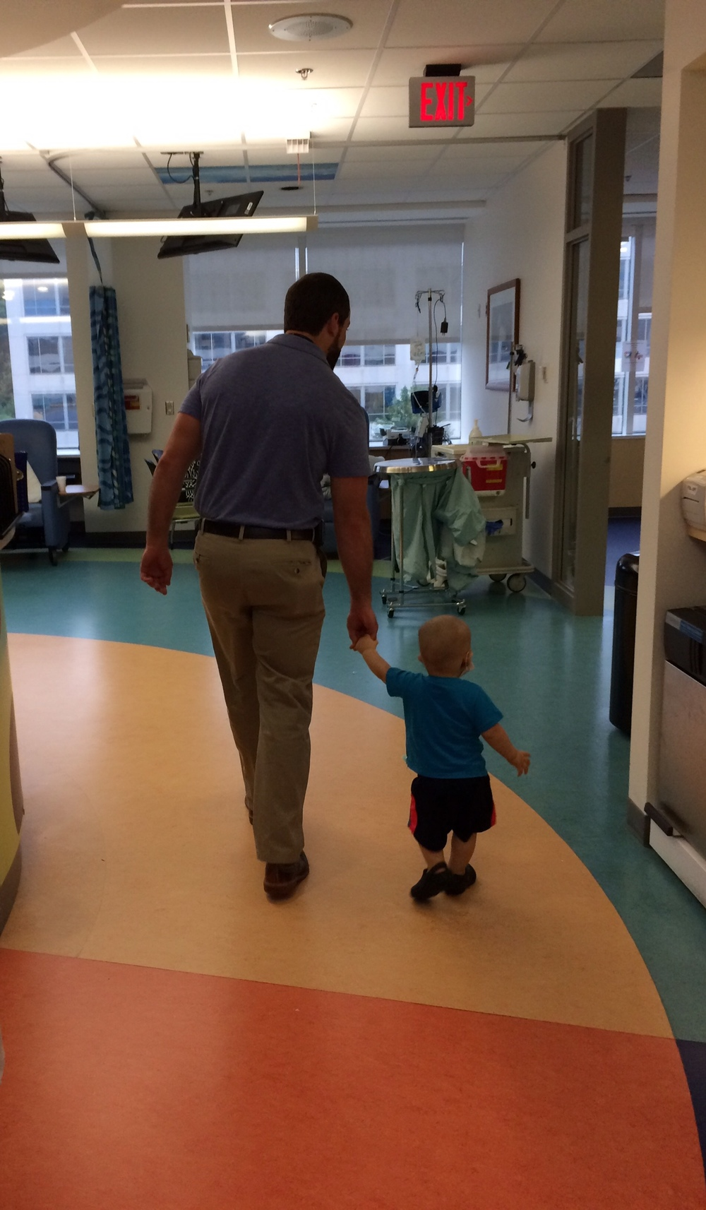 Holding hands with his primary Immunologist/BMT doctor, all along the way