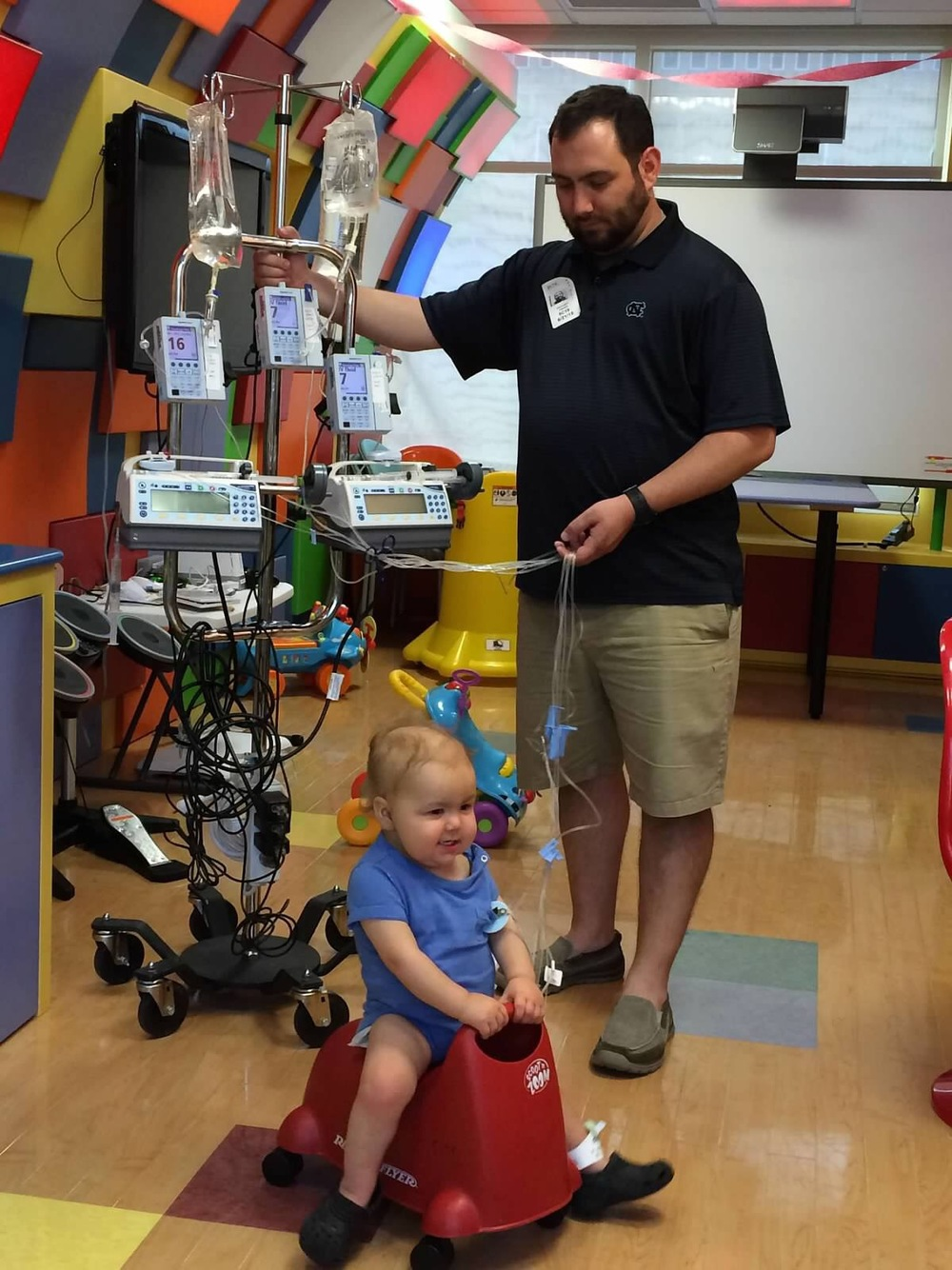 Still having fun in the Lion's Den at NC Children's Hospital, even with his quad IV pole and a blood infection post bone marrow transplant