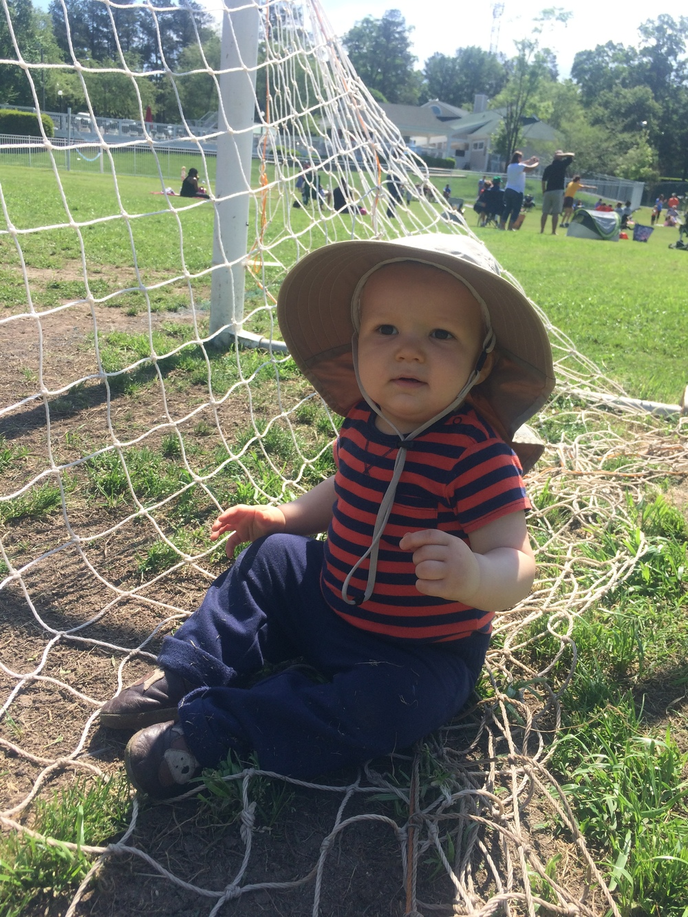 Luka at his big sister's soccer game in April 2015, just hanging out in the net