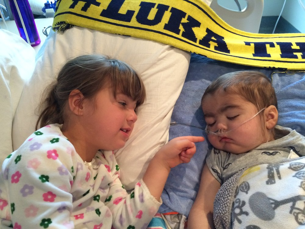 Luka's big sister was granted special permission by the hospital to visit him in the PICU during flu restriction season so that she could say goodbye. The big bed was provided so they could be close to each other.