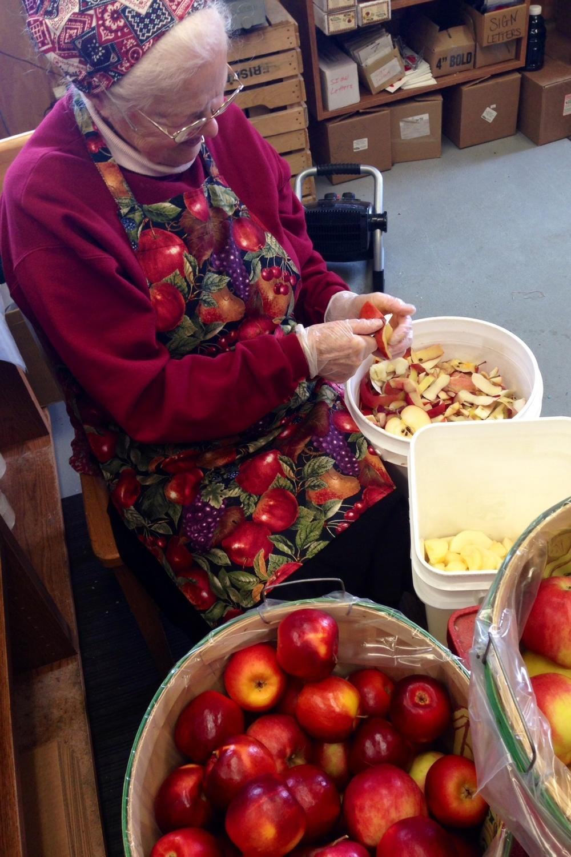 Oma Friske peeling apples for applesauce at Friske's Farm Market