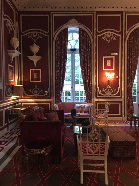 The Red Sitting room restored with fabric walls and original mouldings.