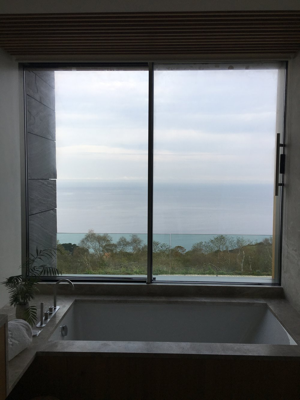 This is the bath of my dreams - wide open to nature and the sea below. I watched the sun set dreaming of the next spaces I'd create while soaking away....