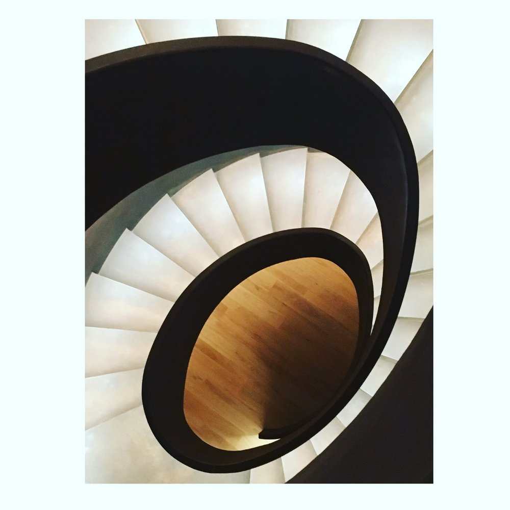 Who does this? It's a perfect oval spiral in a new building that is linear in design - punctuated contrast or what?