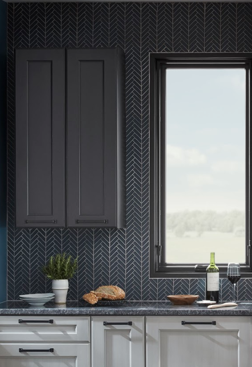 Navy herringbone glass tile adds a tailored spin to the industrial design.