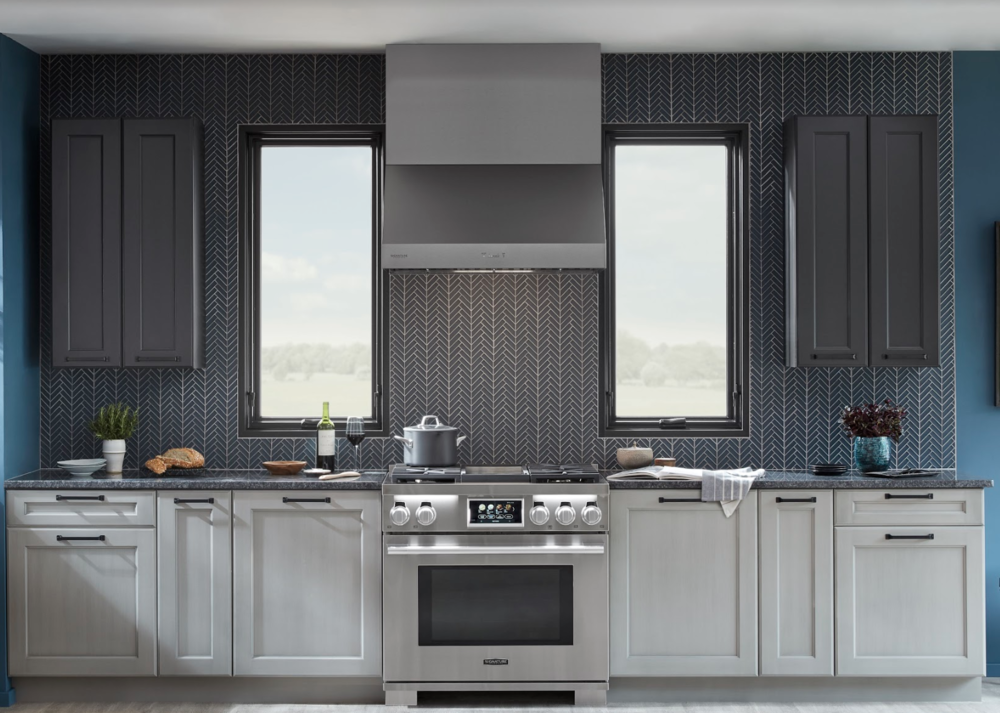 The Signature Kitchen Suite 36-inch Dual-Fuel Pro Range and matching Vent Hood.