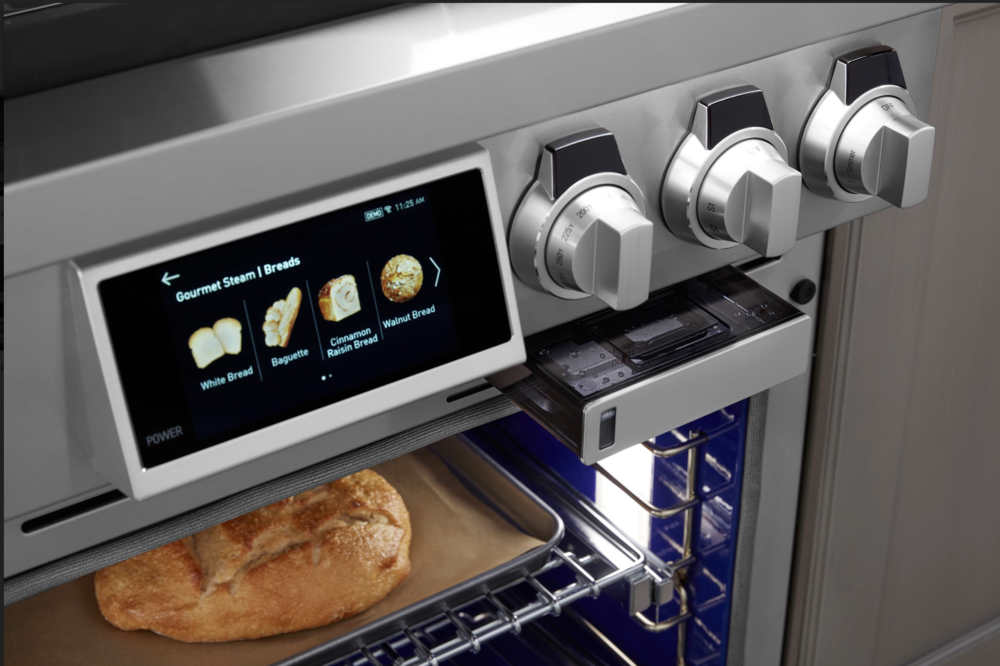 The Signature Kitchen Suite Pro Range with the largest capacity steam-assist  convection oven features an internal water reservoir.