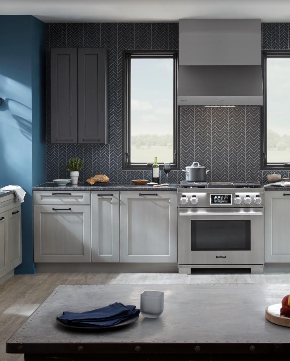 """Custom interior design featuring Signature Kitchen Suite including the 36"""" Dual-Fuel Pro Range."""