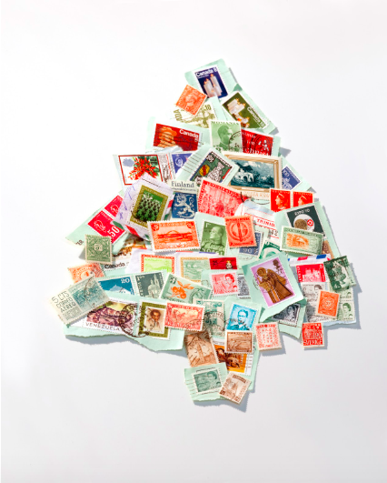 A vintage stamp collection becomes a conifer created by photostylist Barbara Schmidt, studiobstyle. Photographer Todd Hafermann.