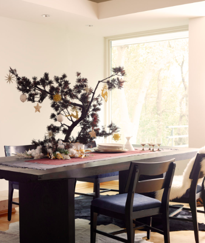 Interior Designer Barbara Schmidt sets the holiday table with photographer Alex Hayden.