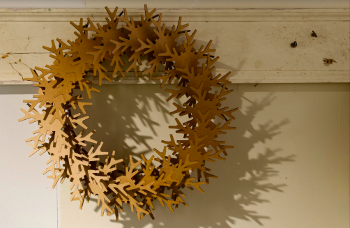 Snowflake cardboard wreath has some assembly required…. But all worth it in the end it is amazing! Creative Director Barbara Schmidt, studiobstyle.