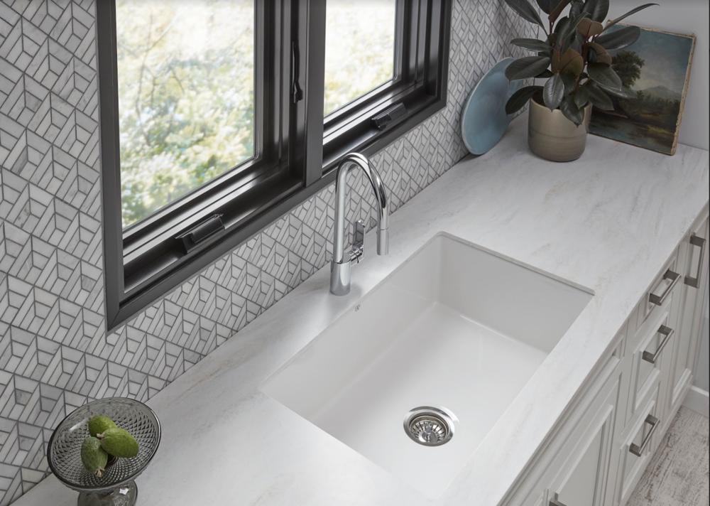Interior Designer Barbara Schmidt features black  Weather Shield Windows  in a custom kitchen with  Decora Cabintets ,  Wilsonart  Countertop,  DXV  fixtures,  Jeffrey Court Tile  backsplash,  Hafele  Hardware
