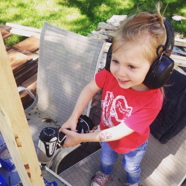 Ruby helping out with the screw gun on the back patio. Who's that on the radio?