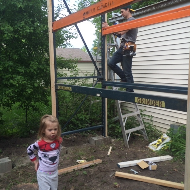 Ruby helping out Dad with new siding and roofing. She knows how to swing a hammer!