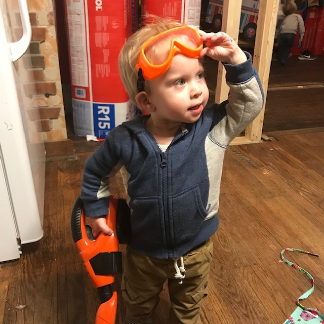 Eero handling the hand vac like a power tool. Safety googles are a must!