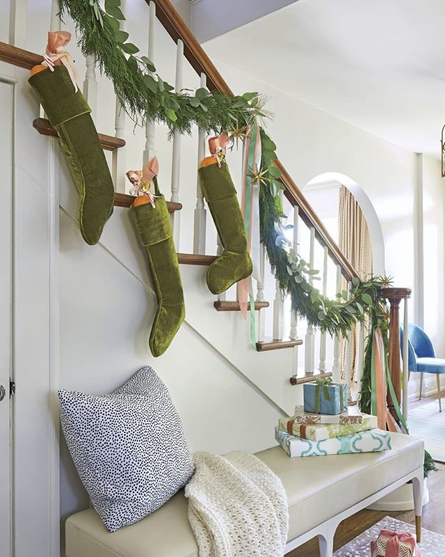 Who's ready for Santa? If you don't have a mantle or need more space for all your stockings, hang them from the banister like @southernlivingmag did at our #clermontproject. #ketchamandco #southernliving Greenery: @liltflorals  Produced by: @rachaelburrow  Photographer: @hectormsanchezphoto