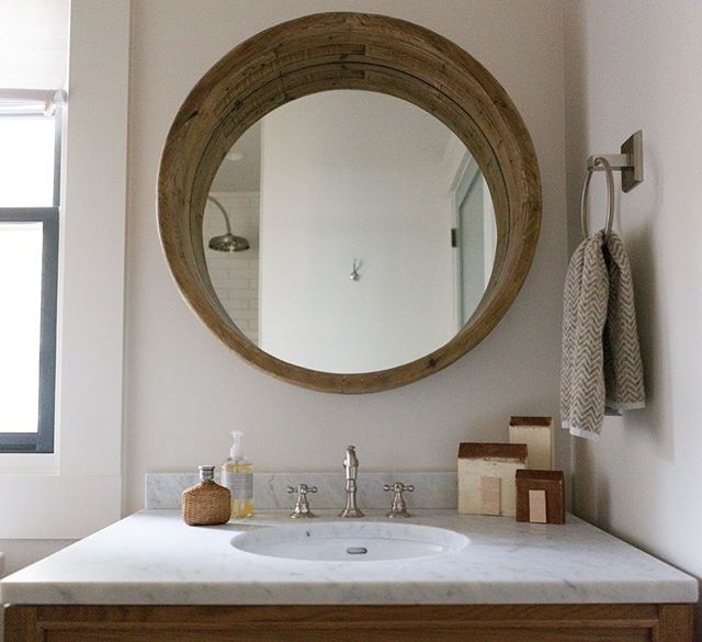 As much as we love color and pattern at #ketchamandco, we also believe in showing off the beauty of natural materials like wood and stone in this bathroom.