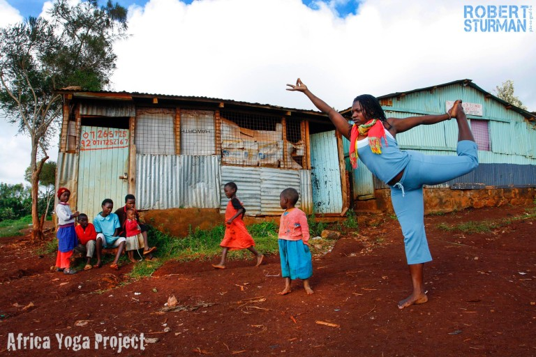 Yoga in the village near Nairobi.   Irene Auma   of the AYP in Dancer's Pose (Natarajasana).
