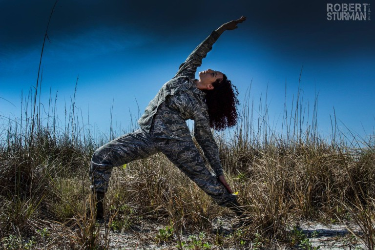 A warrior of peace—United States Air Force Staff Sergeant Cassandra—photographed on the Gulf Coast of Florida in Peaceful Warrior pose.
