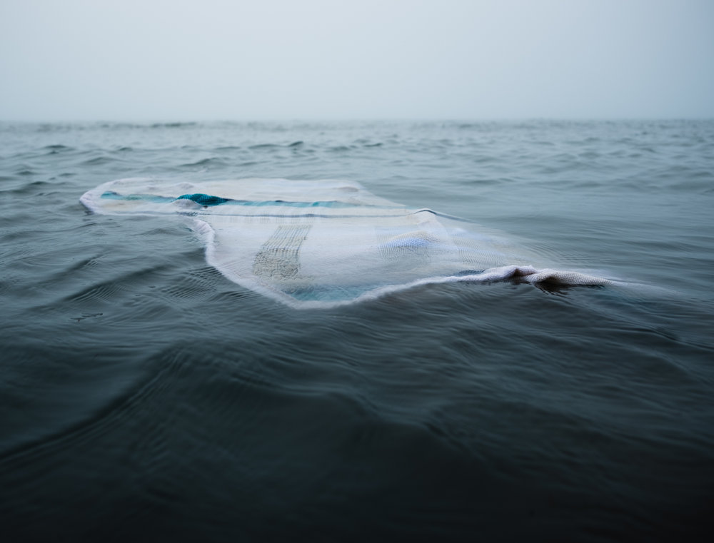 Staysail (Floating)   Photographic Documentation of Performance with Handwoven Sail, 2018  photo credit Ben Dembroski