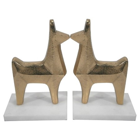 """During my time working in magazines, I collected a large selection of fashion and decorative coffee table books. I absolutely love these little  l lama bookends ( $19.99 )—they liven up my bookcase and keep things fun!"""