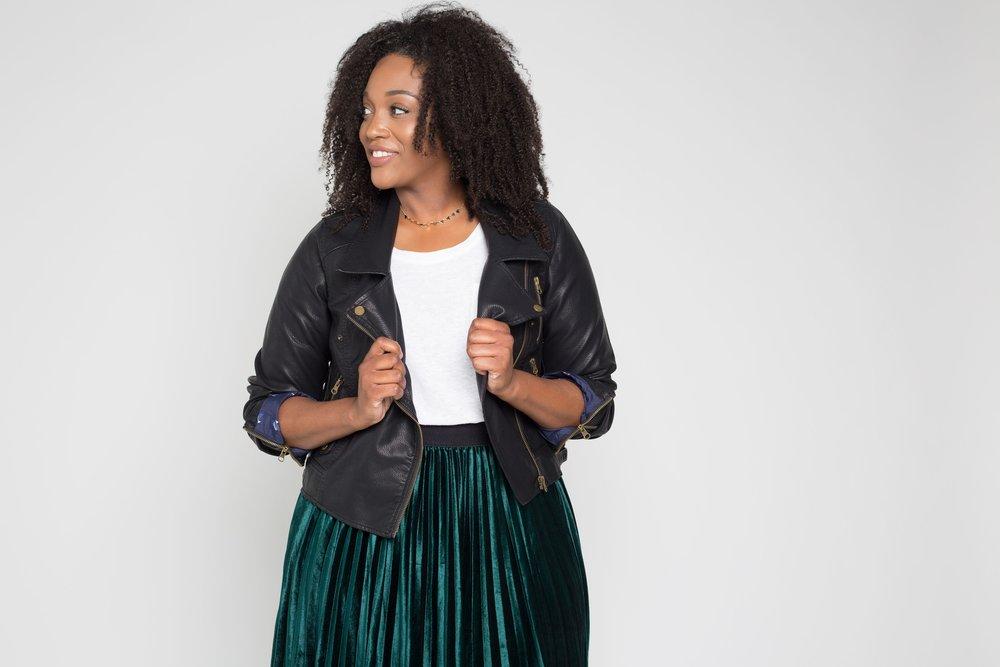 Jacket:  Moto Op Jacket, $59.99; modcloth.com . Top:  Boyfriend Pocket Tee, $10; oldnavy.com . Skirt:  Heart Set On Velvet Midi Skirt, $47.99; modcloth.com . Necklace:  Courtney Triangle Choker, $32; oliveandpiper.com .