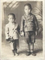 On the left, as a young boy in the 1940s